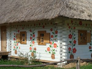 White-washed hut with painted flowers small